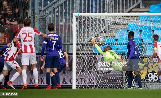 Filip Lesniak of AaB Aalborg scores the 11 goal against Goalkeeper Bill Hamid of FC Midtjylland during the Danish Alka Superliga match between AaB...