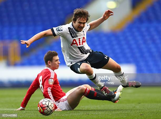 Filip Lesniak of Spurs is fouled by Donald Love of Man Utd during the U21 Barclays Premier League match between Tottenham Hotspur and Manchester...