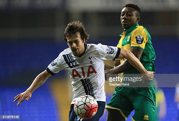 Filip Lesniak of Tottenham Hotspur and Benny AshleySeal of Norwich City compete for the ball during the Barclays U21 Premier League match between...
