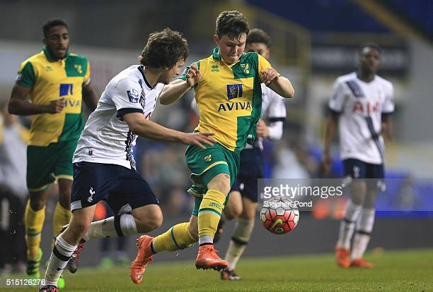 Filip Lesniak of Tottenham Hotspur and Glenn Middleton of Norwich City compete for the ball during the Barclays U21 Premier League match between...
