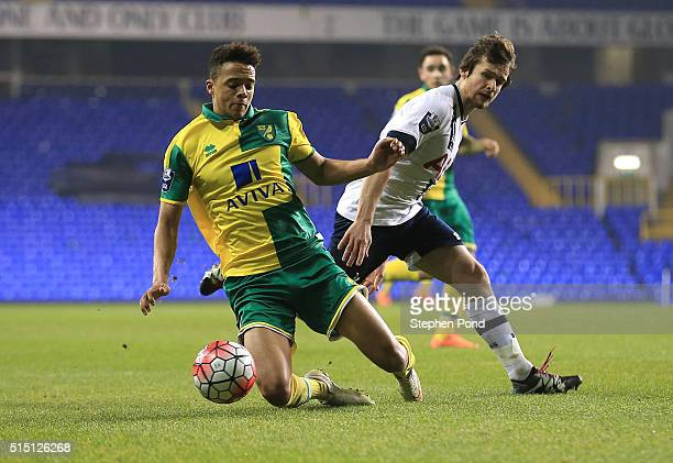 Filip Lesniak of Tottenham Hotspur and Jamal Lewis of Norwich City compete for the ball during the Barclays U21 Premier League match between...