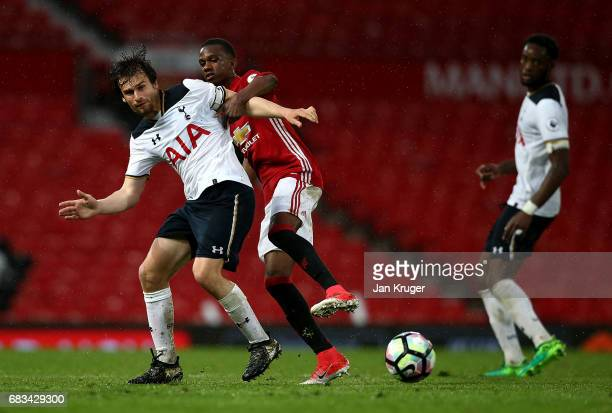 Filip Lesniak of Tottenham Hotspur battles with Joshua Bohui of Manchester United during the Premier League 2 match between Manchester United and...
