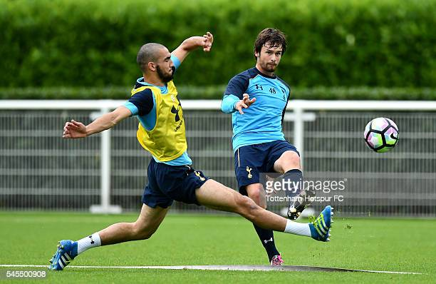 Filip Lesniak of Tottenham Hotspur passes under pressure from Nabil Bentaleb of Tottenham Hotspur during a training session at the Tottenham Hotspur...