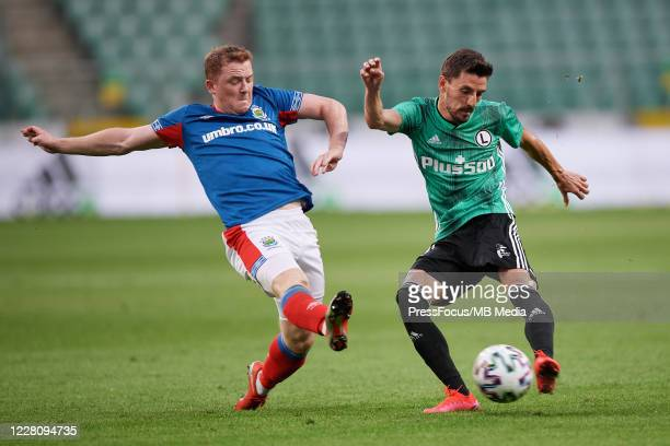 Filip Mladenovic of Legia passes the ball during UEFA Champions League First Qualifying Round match between Legia Warsaw and Linfield at Stadion...