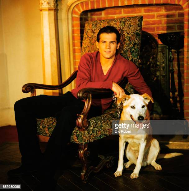 Filip Nikolic a singer with the boy band 2Be3 with his pet dog Simba a crossbreed labrador who was named by a fan Nikolic is campaigning for the...