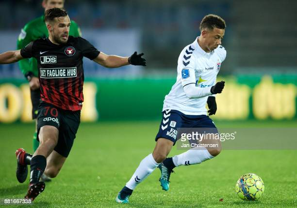 Filip Novak of FC Midtjylland and Tobias Sana of AGF Arhus compete for the ball during the Danish Alka Superliga match between FC Midtjylland and AGF...