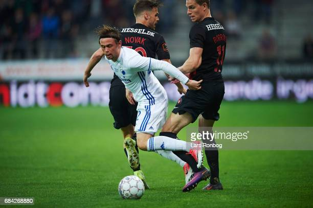 Filip Novak of FC Midtjylland Peter Ankersen of FC Copenhagen and Andreas Cornelius of FC Copenhagen compete for the ball during the Danish Alka...