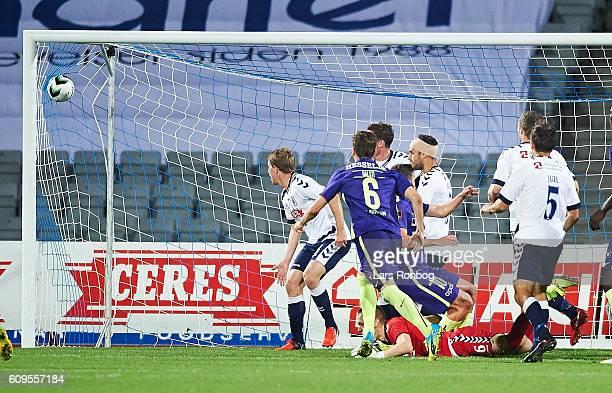 Filip Novak of FC Midtjylland scores the 11 goal against Goalkeeper Aleksandar Jovanovic of AGF Aarhus during the Danish Alka Superliga match between...