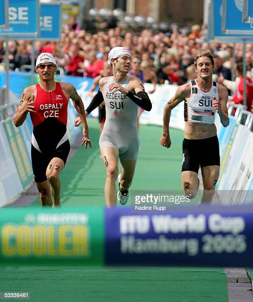 Filip Ospaly of Czech Republic and Sven Riederer and Reto Hug of Switzerland are the first three who reached the finish during the Holsten City Man...