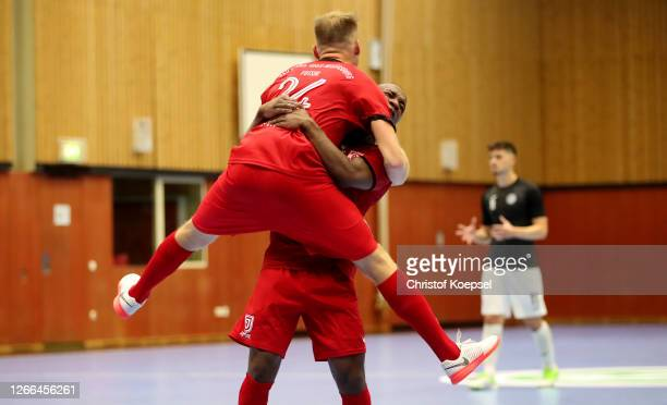 Filip Palutka of Regensburg celebrates the decision seventh goal with Simao Sanches Tavares of Regensburg during the first Semi Final match between...