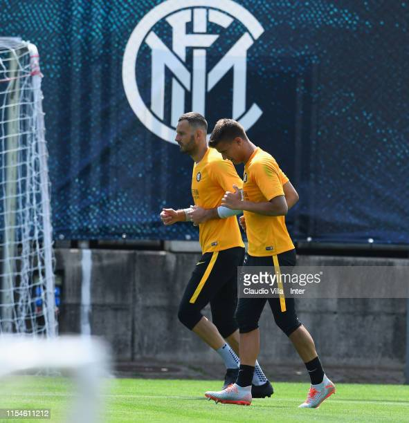 Filip Stankovic and Samir Handanovic of FC Internazionale in action during a training session on July 8 2019 in Lugano Switzerland