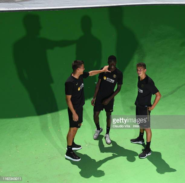 Filip Stankovic Lucien Agoume and Sebastiano Esposito of FC Internazionale pose for a photo before a FC Internazionale training session on July 12...