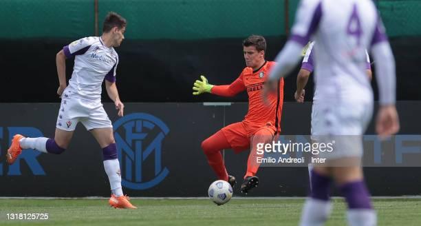 Filip Stankovic of FC Internazionale U19 makes a save on Niccolo Pierozzi of ACF Fiorentina U19 during the Primavera 1 TIM match between FC...