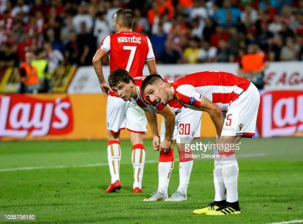 Filip Stojkovic and Milos Degenek of Crvena Zvezda look on during the Group C match of the UEFA Champions League between Crvena Zvezda Belgrade and...