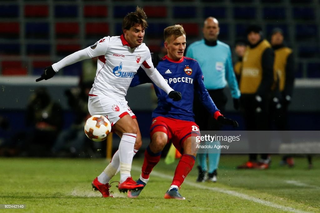 Filip Stojkovic (L) of Crvena Zvezda in action against Konstantin Kuchaev (R) of CSKA Moscow during the UEFA Europa League round of 32, second leg soccer match between CSKA Moscow and Crvena Zvezda at the Stadium CSKA Moscow in Moscow, Russia on February 21, 2018.