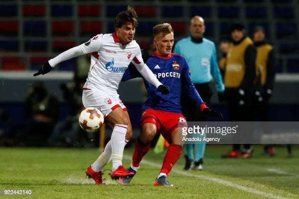 Filip Stojkovic of Crvena Zvezda in action against Konstantin Kuchaev of CSKA Moscow during the UEFA Europa League round of 32 second leg soccer...