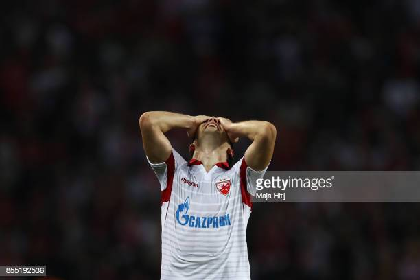 Filip Stojkovic of Crvena zvezda reacts after a missed chance on goal during the UEFA Europa League group H match between 1 FC Koeln and Crvena...