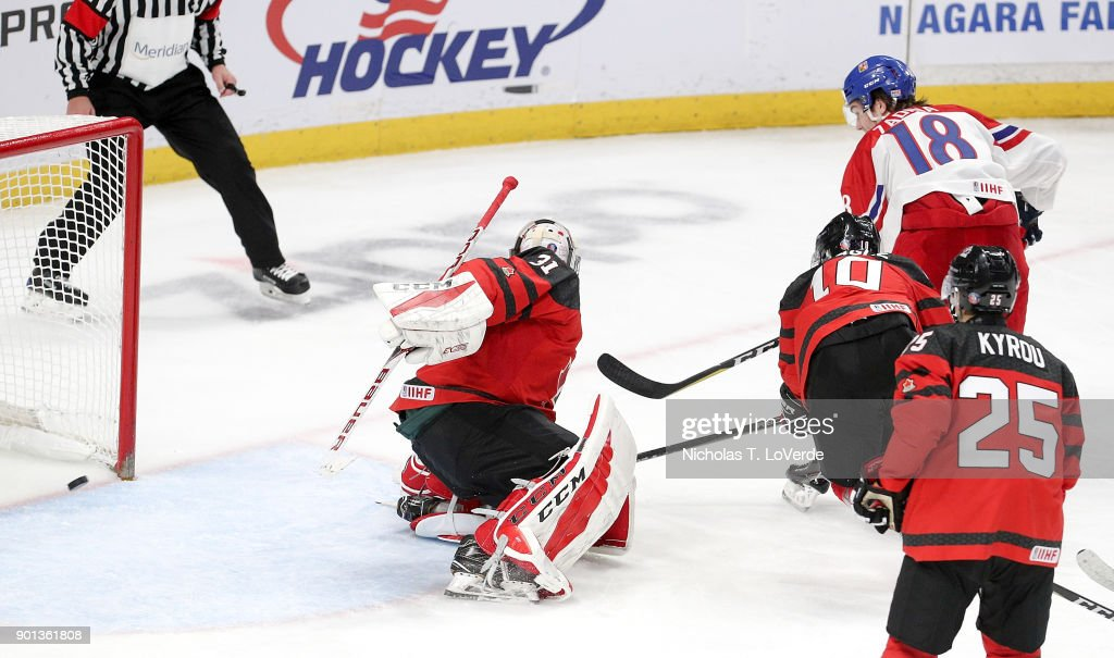 Filip Zadina #18 of Czech Republic scores his second goal of the game past Carter Hart #31 of Canada during the third period of play in the IIHF World Junior Championships Semifinal game at KeyBank Center on January 4, 2018 in Buffalo, New York.