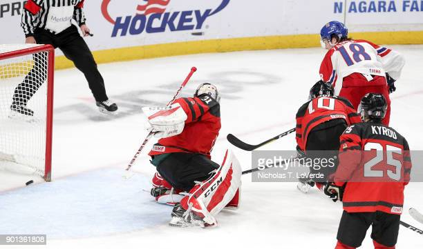 Filip Zadina of Czech Republic scores his second goal of the game past Carter Hart of Canada during the third period of play in the IIHF World Junior...