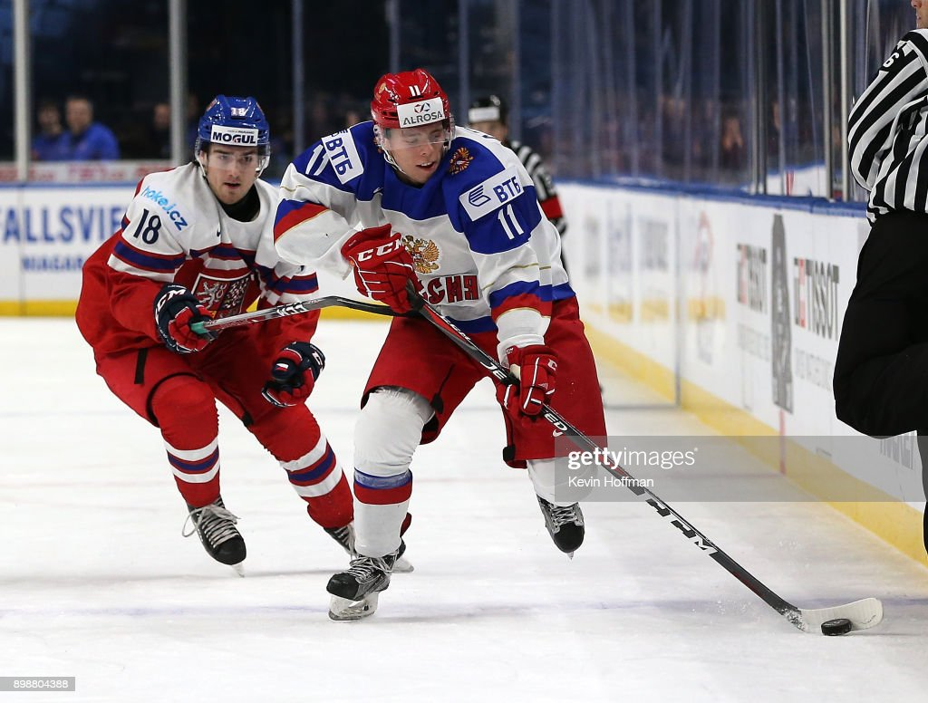 Filip Zadina #18 of the Czech Republic pursues Vitali Abramov #11 of Russia during the third period at KeyBank Center on December 26, 2017 in Buffalo, New York. The Czech Republic beat Russia 5-4.