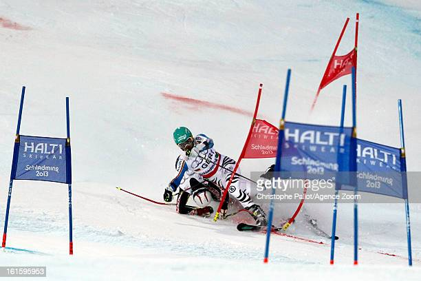 Filip Zubcic of Croatia crashes into Felix Neureuther of Germany during the Audi FIS Alpine Ski World Championships Nation's Team Event on February...
