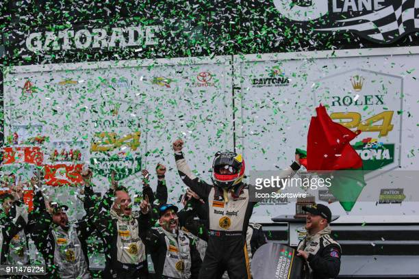 Filipe Albuquerque driver of the Mustang Sampling Racing Cadillac DPiVR celebrates in Victory Lane following the Rolex 24 at Daytona on January 28...
