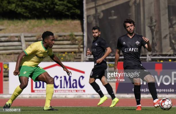 Filipe Chaby of Academica Coimbra with Cuca of CD Mafra in action during the Liga Pro match between CD Mafra and Academica Coimbra at Estadio do...