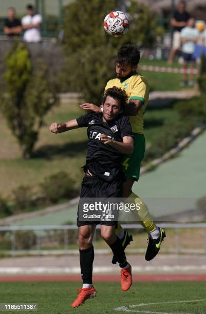 Filipe Chaby of Academica Coimbra with Miguel Lourenco of CD Mafra in action during the Liga Pro match between CD Mafra and Academica Coimbra at...