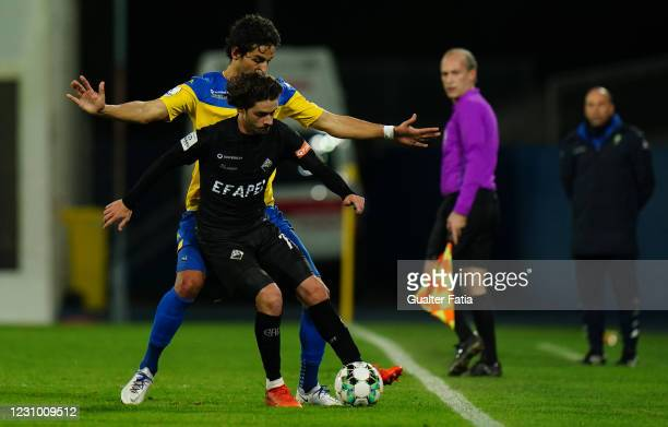 Filipe Chaby of Academica De Coimbra with Marcos Valente of GD Estoril Praia in action during the Liga 2 Sabseg match between GD Estoril Praia and...