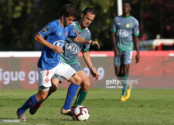 Filipe Chaby of Belenenses SAD with Ruben Micael of Vitoria FC in action during the Liga NOS match between Belenenses SAD and Vitoria FC at Estadio...