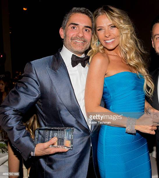 Filipe Diniz and Adriene Galisteu attend the 5th Annual amfAR Inspiration Gala at the home of Dinho Diniz on April 10 2015 in Sao Paulo Brazil
