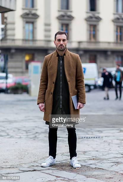 Filipe Fangueiro is wearing a brown coat zip jacket skinny jeans white sneaker on January 12 2017 in Florence Italy