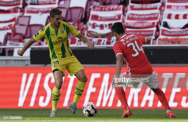 Filipe Ferreira of CD Tondela with Andre Almeida of SL Benfica in action during the Liga NOS match between SL Benfica and CD Tondela at Estadio da...