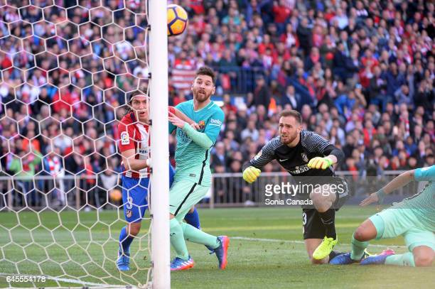 Filipe Luis #3 of Atletico de Madrid and Lionel Messi #10 of FC Barcelona and Jan Oblak #13 of Atletico de Madrid during The La Liga match between...
