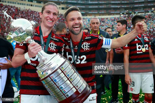 Filipe Luis and Diego of Flamengo pose with the Copa Libertadores trophy after the final match of Copa CONMEBOL Libertadores 2019 between Flamengo...