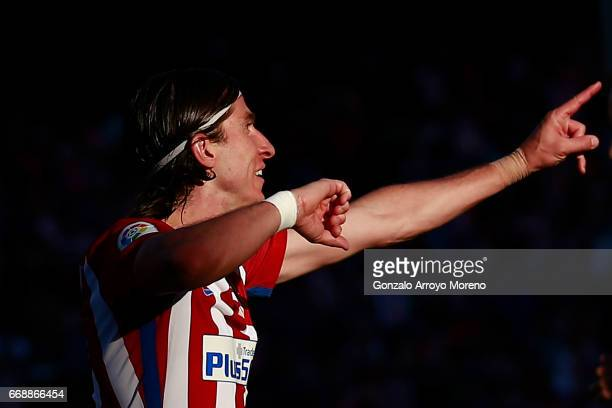 Filipe Luis celebrates scoring their third goal during the La Liga match between Club Atletico de Madrid and CA Osasuna at Vicente Calderon Stadium...