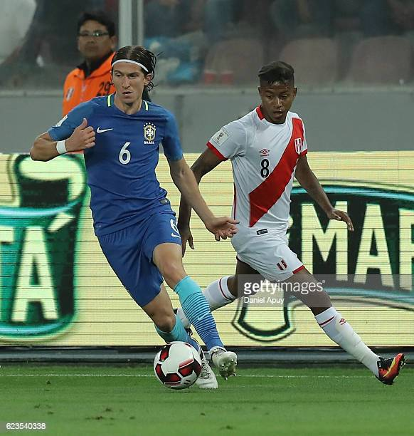 Filipe Luis drives the ball as followed by Andy Polo of Peru during a match between Peru and Brazil as part of FIFA 2018 World Cup Qualifiers at...
