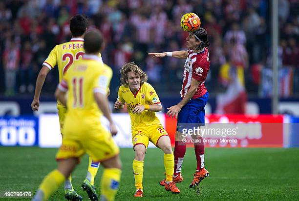 Filipe Luis during the La Liga mathc bewteen Club Atlet of Atletico de Madrid wins the header after Alen Halilovic of Real Sporting de Gijon during...