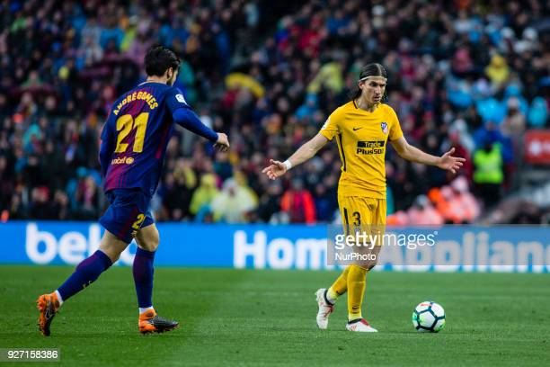 03 Filipe Luis from Brazil of Atletico de Madrid defended by 21 Andre Gomes from Portugal of FC Barcelona during La Liga match between FC Barcelona v...