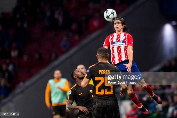 Filipe Luis Kasmirski of Atletico de Madrid flights the ball with Bruno Peres of AS Roma during the UEFA Champions League 201718 match between...
