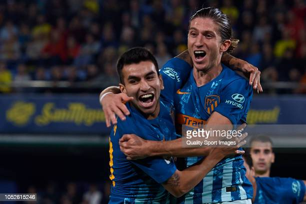 Filipe Luis of Atletico de Madrid celebrates after scoring his sides first goal with his teammate Angel Correa during the La Liga match between...