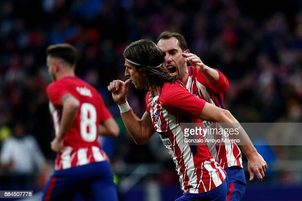 Filipe Luis of Atletico de Madrid celebrates scoring their opening goal with teammate Diego Godin during the La Liga match between Club Atletico...