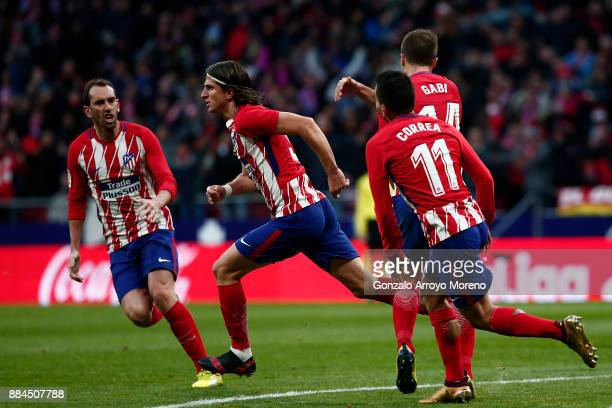 Filipe Luis of Atletico de Madrid celebrates scoring their opening goal with teammates Diego Godin Angel Martin Correa and Gabi Fernandez during the...