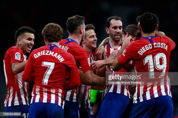 Filipe Luis of Atletico de Madrid celebrates scoring their second goal with teammates Diego Godin Diego Costa Angel Martin Correa Antoine Griezmann...