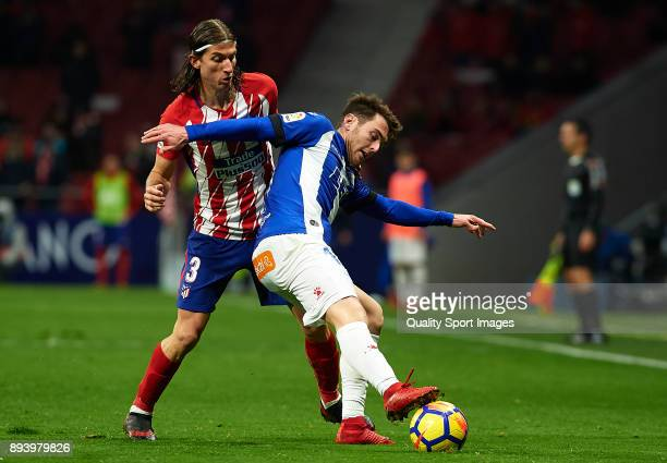 Filipe Luis of Atletico de Madrid competes for the ball with Ibai Gomez of Deportivo Alaves during the La Liga match between Atletico Madrid and...