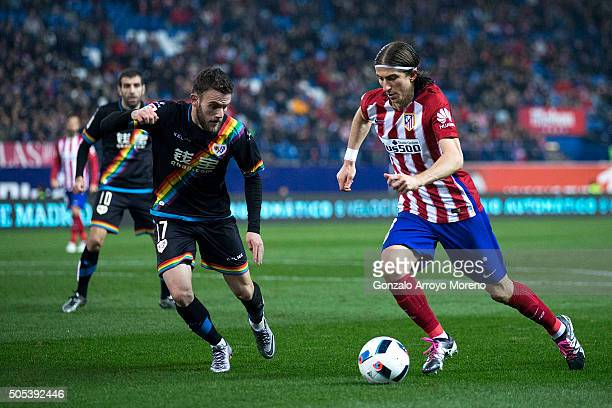 Filipe Luis of Atletico de Madrid competes for the ball with Joaquin Jose Marin alias Quini of Rayo Vallecano de Madrid during the Copa del Rey Round...