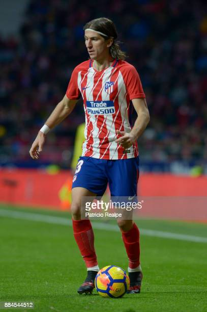 Filipe Luis of Atletico de Madrid drives the ball during a match between Atletico Madrid and Real Sociedad as part of La Liga at Wanda Metropolitano...