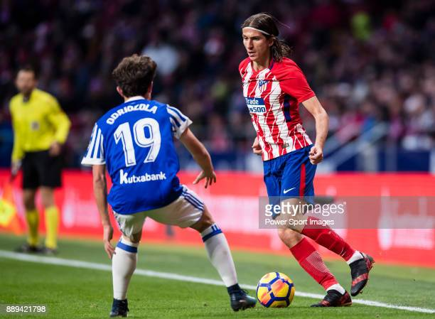 Filipe Luis of Atletico de Madrid fights for the ball with Alvaro Odriozola Arzallus of Real Sociedad during the La Liga 201718 match between...