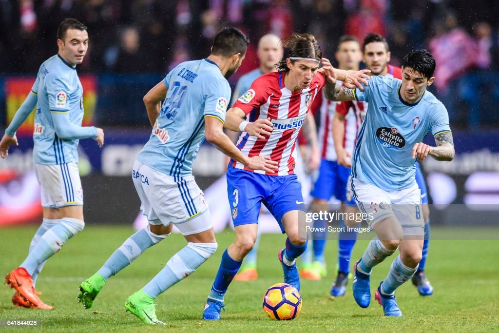 Filipe Luis of Atletico de Madrid fights for the ball with RC Celta de Vigo's players during their La Liga match between Atletico de Madrid and RC Celta de Vigo at the Vicente Calderón Stadium on 12 February 2017 in Madrid, Spain.