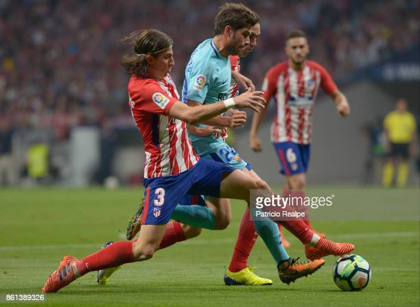 Filipe Luis of Atletico de Madrid fights the ball with Sergi Roberto of Barcelona during a match between Atletico Madrid and Barcelona as part of La...